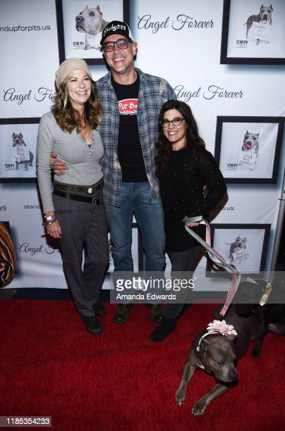 Mo Collins, Alex Skuby and Rebecca Corry arrive with Sally and Todd the Pitbulls at the 9th Annual Stand Up For Pits event hosted by Kaley Cuoco at...