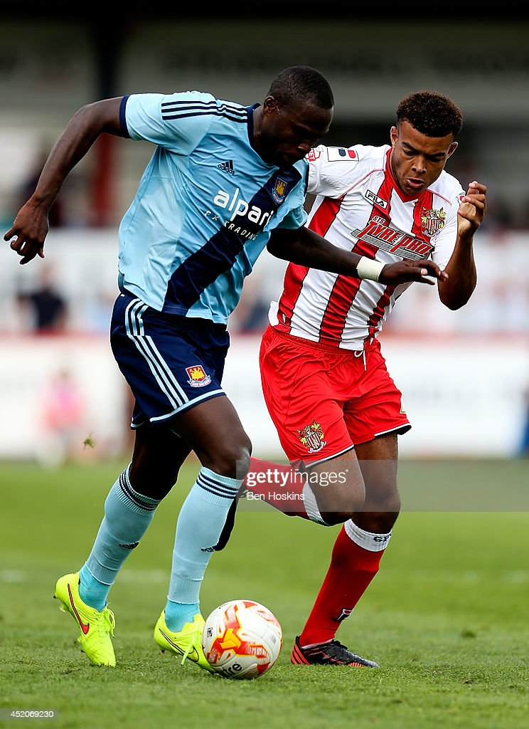Mo Diame of West Ham advances under pressure from Rohdell Gordon of Stevenage during the Pre Season Friendly match between Stevenage and West Ham United at The Lamex Stadium on July 12, 2014 in Stevenage, England.