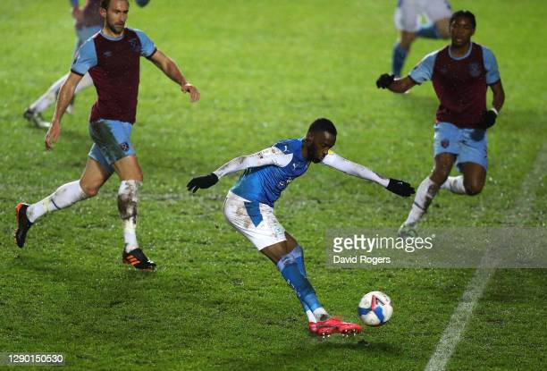 Mo Eisa of Peterborough United scores his second, Peterborough's third goal during the EFL Trophy match between Peterborough United and West Ham...