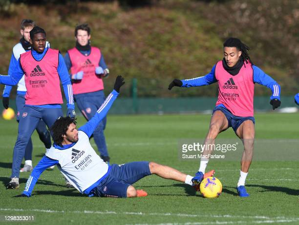 Mo Elneny and Miquel Azeez of Arsenal during a training session at London Colney on January 25, 2021 in St Albans, England.