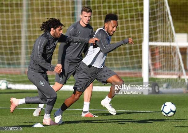 Mo Elneny and Pierre-Emerick Aubameyang of Arsenal during a training session at London Colney on September 28, 2018 in St Albans, England.