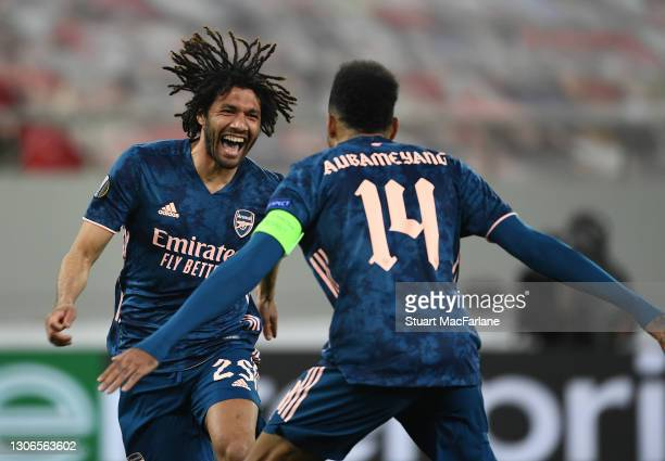 Mo Elneny celebrates scoring the 3rd Arsenal goal with Pierre-Emerick Aubameyang during the UEFA Europa League Round of 16 First Leg match between...