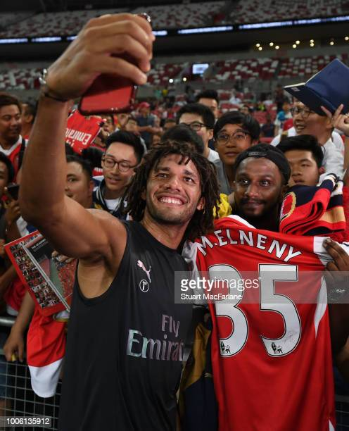 Mo Elneny meets the Arsenal fans after a training session at the Singapore National Stadium on July 27 2018 in Singapore