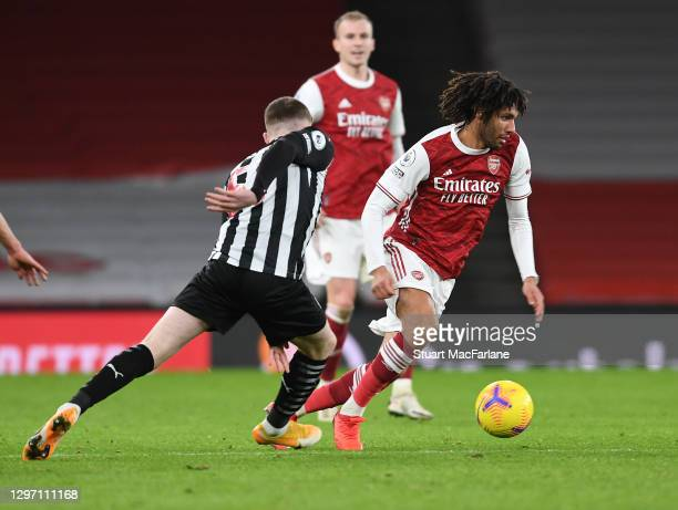 Mo Elneny of Arsenal takes on Elliot Anderson of Newcastle during the Premier League match between Arsenal and Newcastle United at Emirates Stadium...