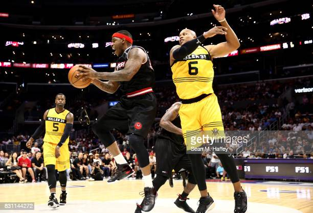 Mo Evans of Killer 3's defends as Rashad McCants of Trilogy grabs a rebound during week eight of the BIG3 three on three basketball league at Staples...