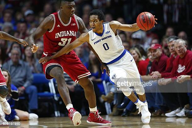 Mo Evans of the Fort Wayne Mastodons dribbles the ball against Thomas Bryant of the Indiana Hoosiers at Memorial Coliseum on November 22 2016 in Fort...