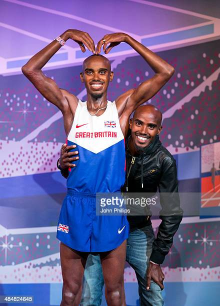 Mo Farah attends a photocall to unveil his 2 waxworks at Madame Tussauds on April 14 2014 in London England