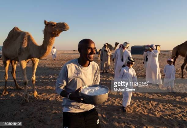 Mo Farah enjoys a drink of camel milk during a desert visit on January 12, 2018 in Doha, Qatar. This image is part of a series following Mo Farah...