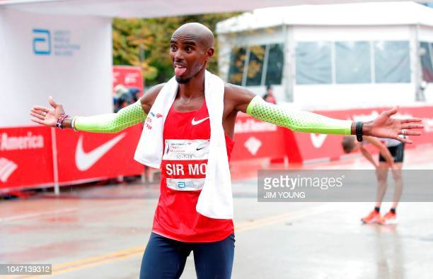 TOPSHOT Mo Farah of Britain celebrates after winning the Chicago Marathon in Chicago on October 7 2018 British athletics star Mo Farah won the...