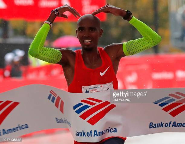 Mo Farah of Britain celebrates as he crosses the finish line to win the Chicago Marathon in Chicago on October 7 2018 British athletics star Mo Farah...