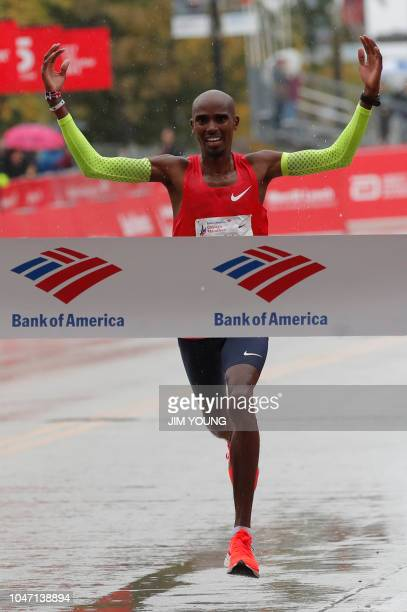 Mo Farah of Britain celebrates as he heads to the finish line to win the Chicago Marathon in Chicago on October 7 2018 British athletics star Mo...