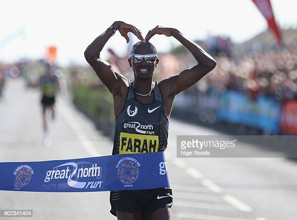 Mo Farah of Britain celebrates winning The Great North Run on September 11 2016 in Newcastle upon Tyne England
