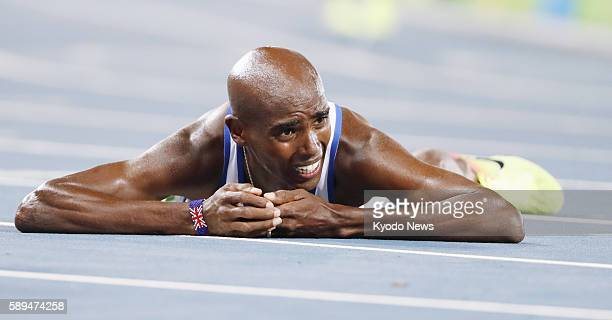 Mo Farah of Britain lies on the track after winning the men's 10000 meters in the athletics competition of the Rio de Janeiro Olympic Games on August...