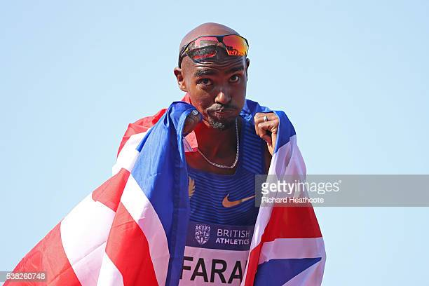 Mo Farah of GB celebrates setting a new British 3000m record during the IAAF Diamond League meeting at Alexander Stadium on June 5 2016 in Birmingham...