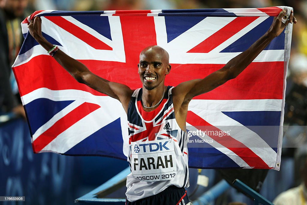 Mo Farah of Great Briatin holds a flag aloft after winning the 5000m Final during Day Seven of the 14th IAAF World Athletics Championships Moscow 2013 at Luzhniki Stadium on August 16, 2013 in Moscow, Russia.