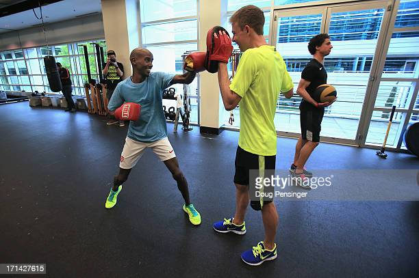 Mo Farah of Great Britain and Galen Rupp of the USA members of the Oregon Project do some cross training at the Nike campus on April 13 2013 in...