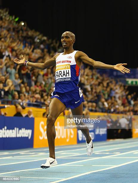 Mo Farah of Great Britain and Northern Ireland crosses the line to win the Men's 2 Miles final during the Sainsbury's Indoor Grand Prix at...