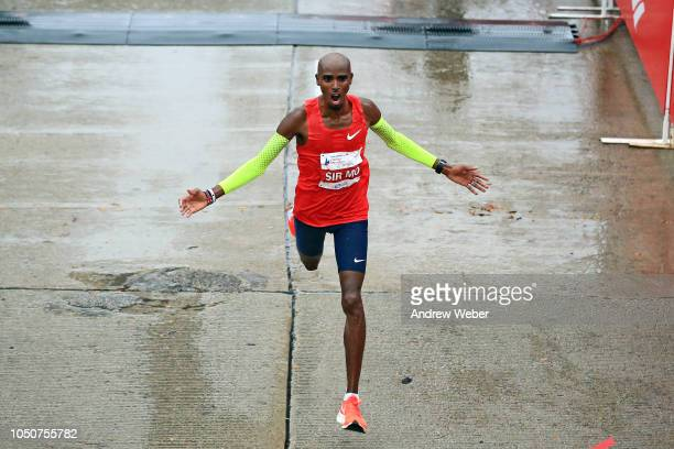 Mo Farah of Great Britain celebrates after winning the 2018 Bank of America Chicago Marathon on October 7 2018 in Chicago Illinois Farah finished in...