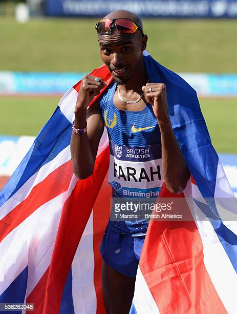 Mo Farah of Great Britain celebrates becoming the new world leader after winning the Men's 3000m during the Birmingham Diamond League at Alexander...