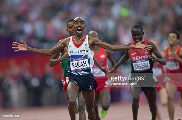 Mo Farah of Great Britain celebrates victory in the Men's 5000m Final on Day 15 of the London 2012 Olympic Games at Olympic Stadium on August 11,...