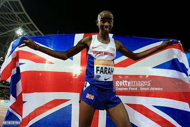 Mo Farah of Great Britain celebrates winning the mens 3000m during day one of the Sainsbury's Anniversary Games IAAF Diamond League event at The...