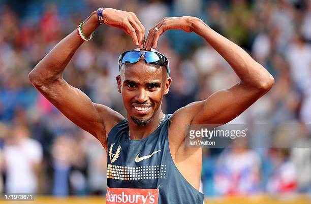 Mo Farah of Great Britain celebrates winning the Mens 500m during the IAAF Diamond League at Alexander Stadium on June 30 2013 in Birmingham England