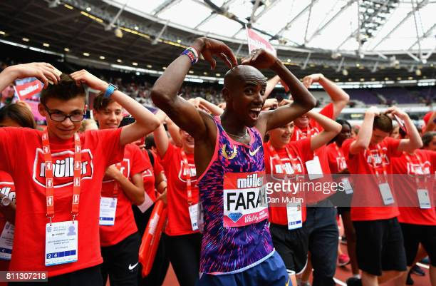 Mo Farah of Great Britain celebrates with fans after he won the Mens 3000m during the Muller Anniversary Games at London Stadium on July 9 2017 in...