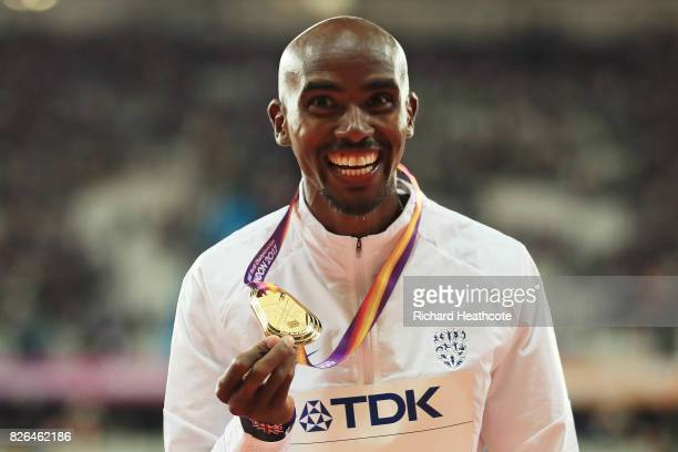 Mo Farah of Great Britain celebrates with his gold medal after winning the Men's 10000 metres final during day one of the 16th IAAF World Athletics...