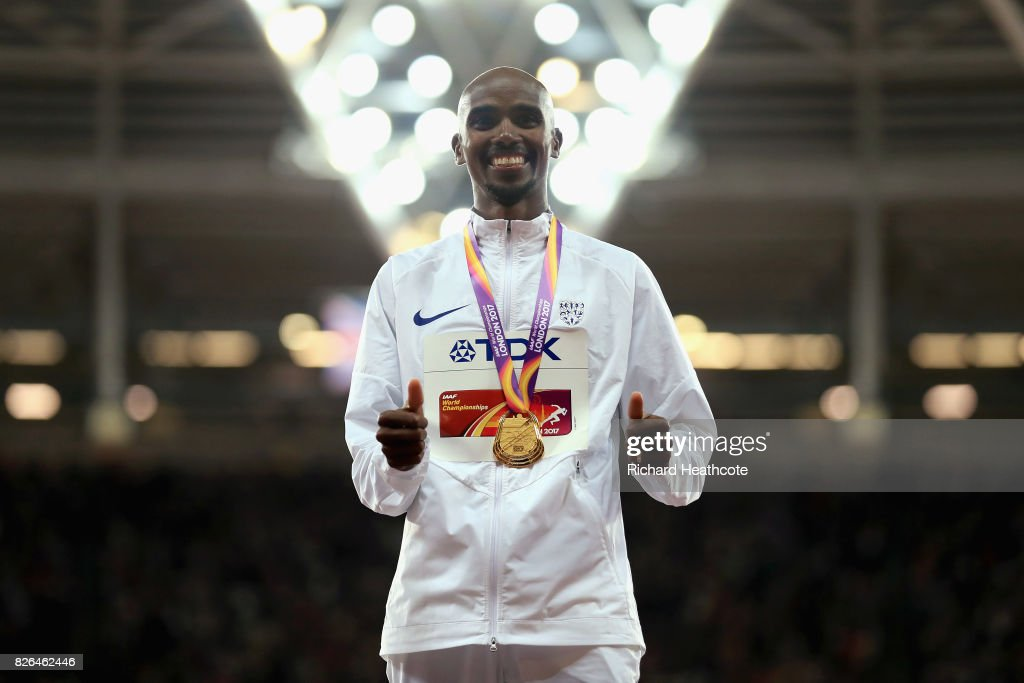 Mo Farah of Great Britain celebrates with his gold medal after winning the Men's 10000 metres final during day one of the 16th IAAF World Athletics Championships London 2017 at The London Stadium on August 4, 2017 in London, United Kingdom.