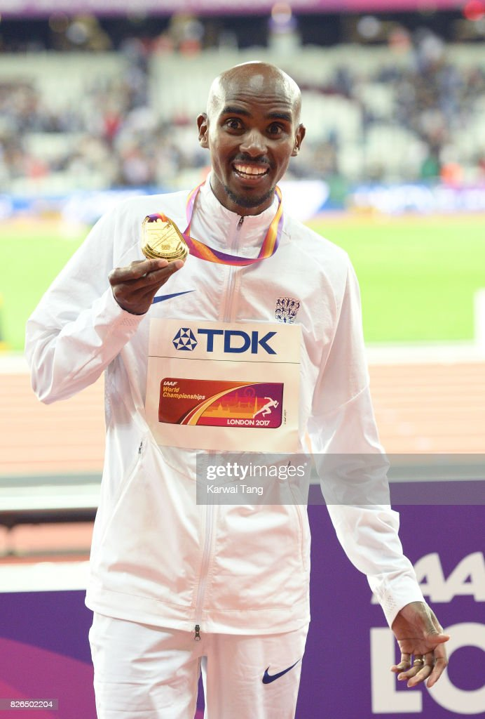 Mo Farah of Great Britain celebrates with his gold medal after winning the men's 10,000 meters during the IAAF World Athletics Championships at the London Stadium on August 4, 2017 in London, United Kingdom.