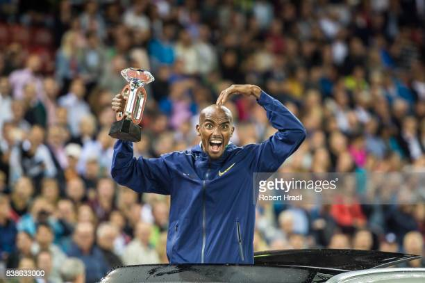 Mo Farah of Great Britain celebrates with the diamond trophy during the Diamond League Athletics meeting 'Weltklasse' on August 24 2017 at the...