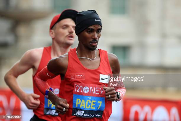 Mo Farah of Great Britain competes in the Elite Men's race during the 2020 Virgin Money London Marathon around St. James's Park on October 04, 2020...