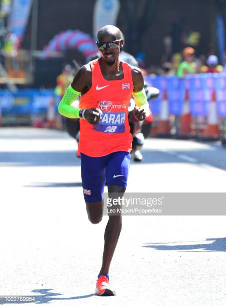 Mo Farah of Great Britain competes in the Elite Men's Race in the Virgin London Marathon on April 22 2018 in London Farah was the third placed runner...