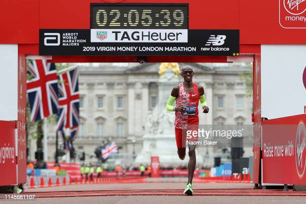 Mo Farah of Great Britain crosses the finish line in 20539 during the Men's Elite race during the Virgin Money London Marathon at United Kingdom on...