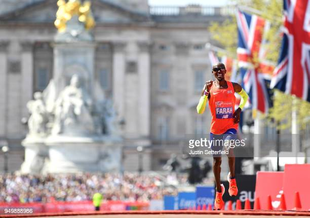 Mo Farah of Great Britain crosses the finish line to take third place during the Virgin Money London Marathon at United Kingdom on April 22 2018 in...