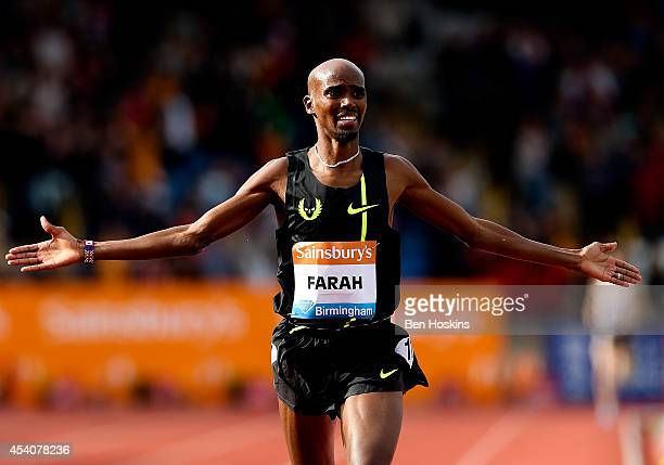 Mo Farah of Great Britain crosses the finish line to win the Men's 2 mile during the Diamond League at Alexander Stadium on August 24 2014 in...