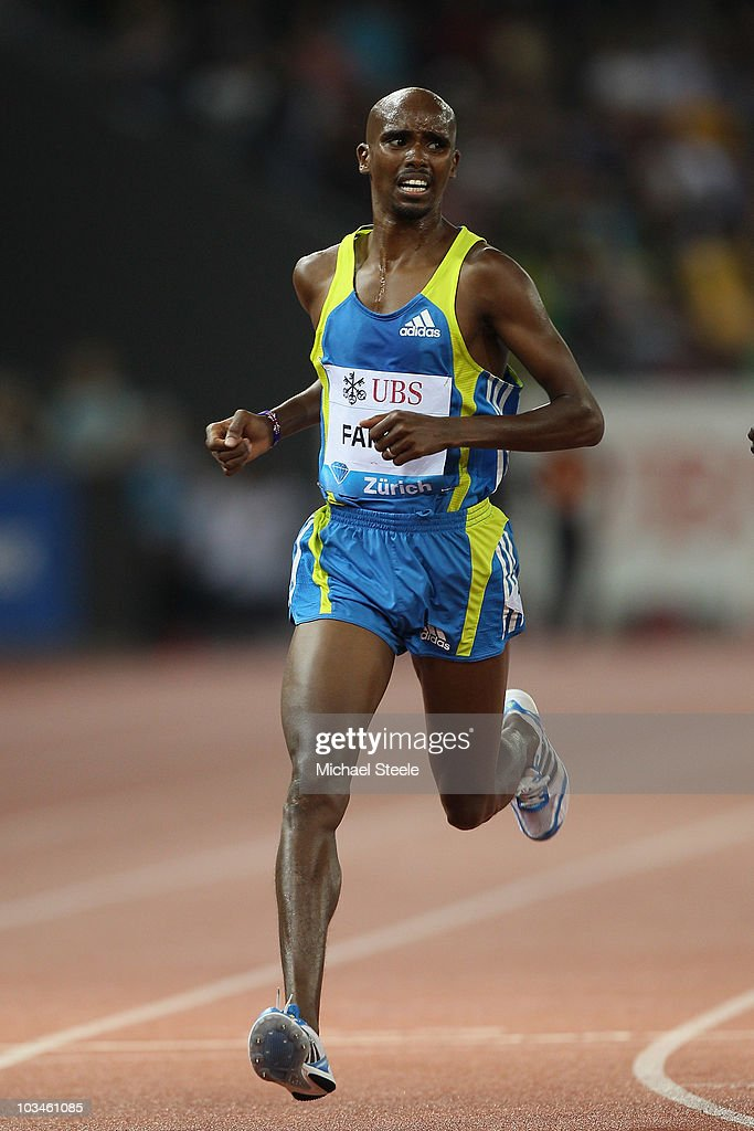 Mo Farah of Great Britain crosses the finishing line and sets a new national record for the men's 5000m with a time of 12:57.94 during the Iaaf Diamond League meeting at the Letzigrund Stadium on August 19, 2010 in Zurich, Switzerland.