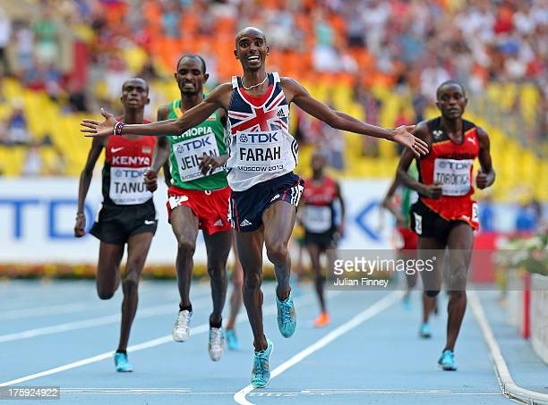 Mo Farah of Great Britain crosses the line to win gold in the Men's 10000 metres final during Day One of the 14th IAAF World Athletics Championships...