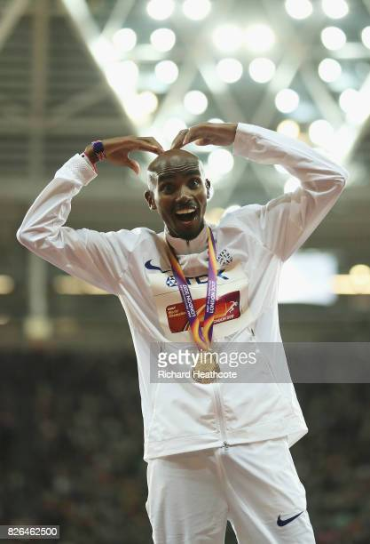 Mo Farah of Great Britain does the mobot as he celebrates with his gold medal after winning the Men's 10000 metres final during day one of the 16th...