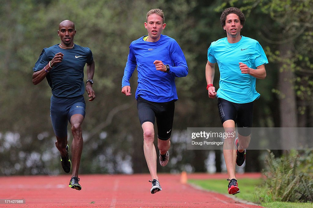 Mo Farah of Great Britain, Galen Rupp of the USA and Cam Levins of Canada, members of the Oregon Project, train on the track at the Nike campus on April 13, 2013 in Beaverton, Oregon.