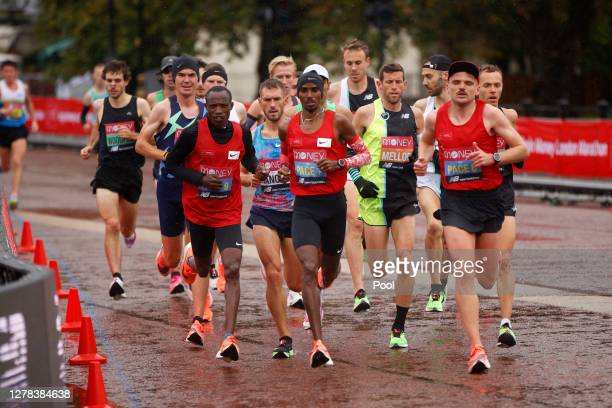 Mo Farah of Great Britain leads his group as they compete in the Elite Men's race during the 2020 Virgin Money London Marathon around St. James's...