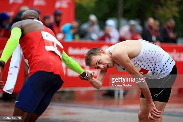 Mo Farah of Great Britain left congratulates Galen Rupp after Farah won the 2018 Bank of America Chicago Marathon on October 7 2018 in Chicago...