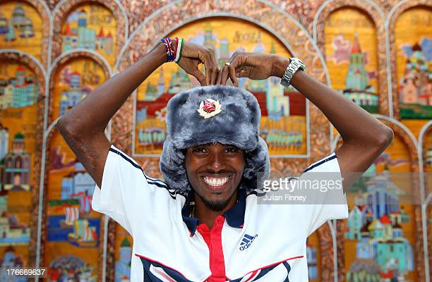 Mo Farah of Great Britain poses for a photo at the Crowne Plaza Hotel following his second Gold medal win in the 5,000m at Luzhniki Stadium on August...