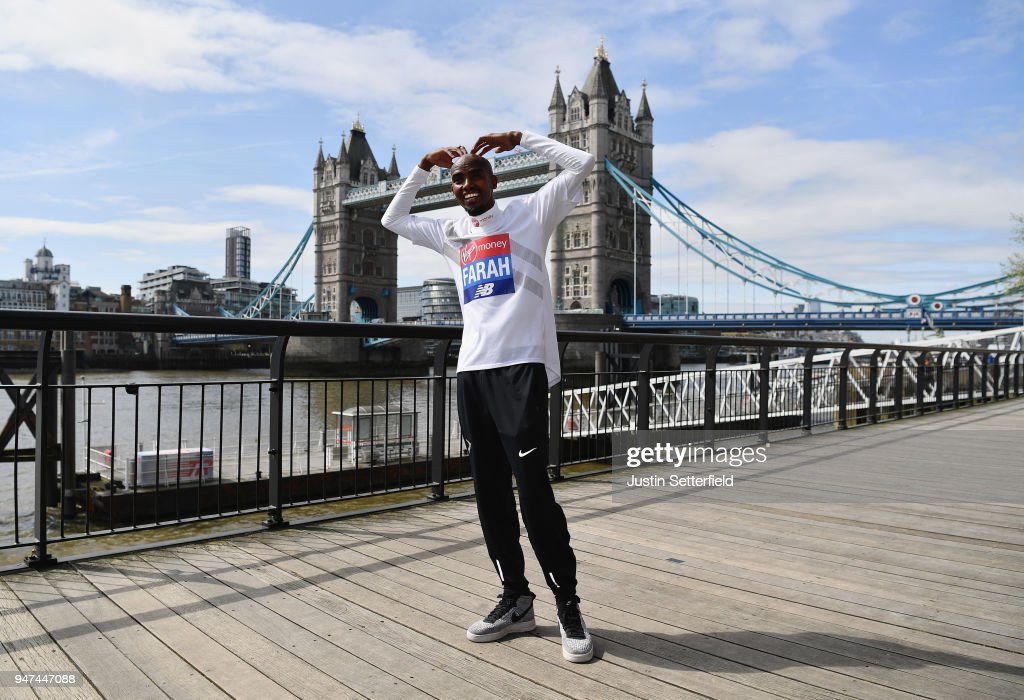 Mo Farah of Great Britain poses in front of Tower Bridge prior to the weekends Virgin Money London Marathon on April 17, 2018 in London, England.