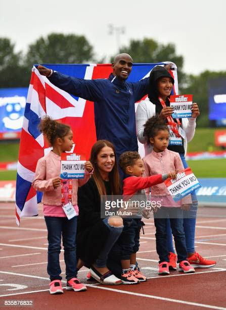 Mo Farah of Great Britain poses with his family after he won the Men's 3000m his last UK track race during the Muller Grand Prix Birmingham as part...