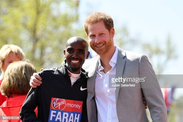 Mo Farah of Great Britain poses with HRH Prince Harry following the Virgin Money London Marathon at United Kingdom on April 22 2018 in London England