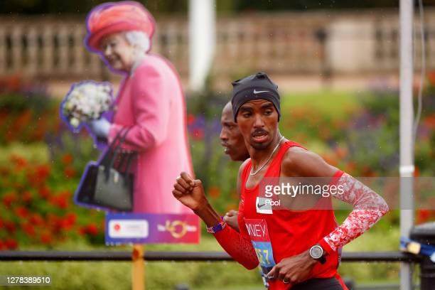 Mo Farah of Great Britain runs as a pacer during the Elite Men's race during the 2020 Virgin Money London Marathon around St. James's Park on October...