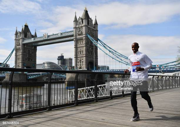 Mo Farah of Great Britain runs in front of Tower Bridge prior to the weekends Virgin Money London Marathon on April 17 2018 in London England