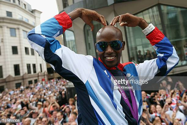 Mo Farah poses for a photograph during the London 2012 Victory Parade for Team GB and Paralympic GB athletes on September 10 2012 in London England