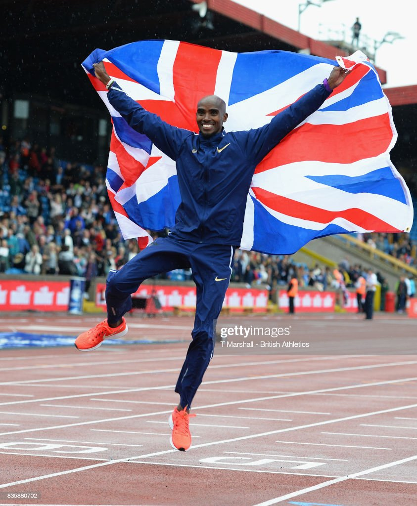 Mo Farah poses with the Union Flag after winning the men's 3000m during the Muller Grand Prix and IAAF Diamond League event at Alexander Stadium on August 20, 2017 in Birmingham, England.